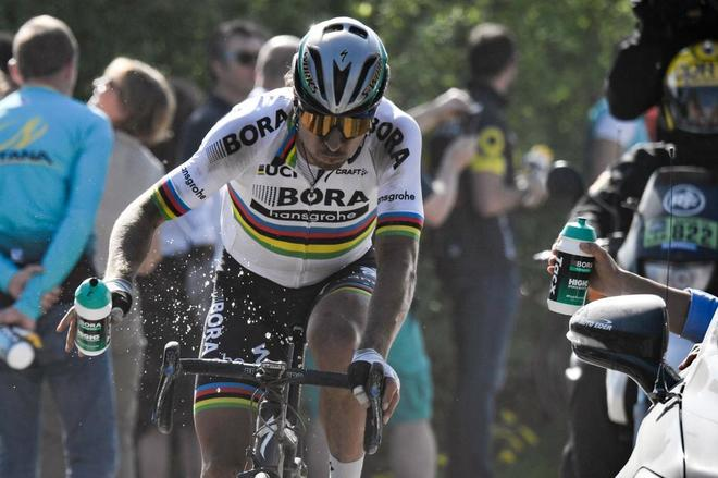 Slovakia's Peter Sagan drinks as he rides during the 115th edition of...