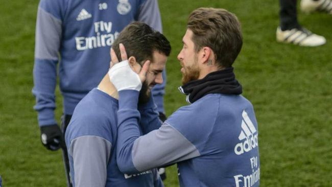 Ramos y Nacho durante un entrenamiento en Valdebebas