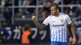Sandro celebra un gol con el M�laga