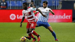 Miguel Torres, con la camiseta del Málaga, en un partido de la...