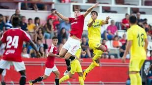 Un lance del partido disputado en el Nou Estadi.