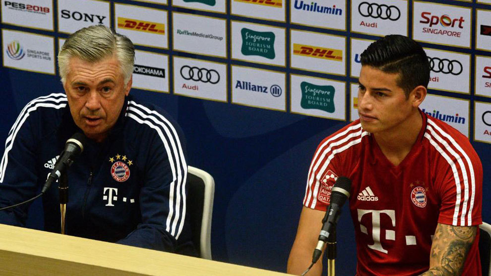 Carlo Ancelotti, with James Rodríguez, in a press conference