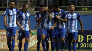 El Málaga celebran un gol en el Carranza.