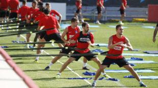 Gabi, Juanfran y Koke en la sesión matinal de entrenamiento