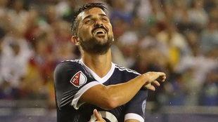 David Villa se lamenta de una ocasión fallada.