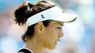 Muguruza (23) luce un cresp�n negro en su partido ante Svetlana...