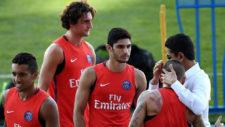 Guedes, durante un entrenamiento del PSG junto a Rabiot y Marquinhos.