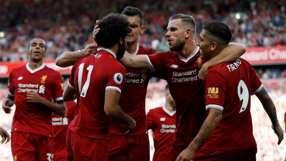 Los jugadores del Liverpool celebran el gol de Salah