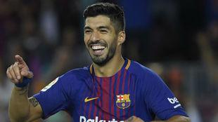 Luis Suárez celebra su gol en el derbi.
