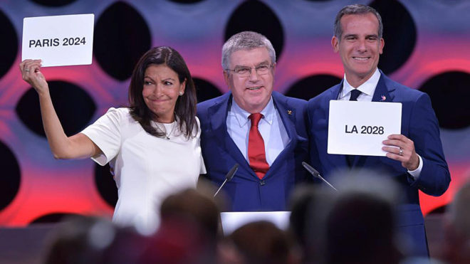 IOC President Thomas Bach poses with Paris Mayor, Anne Hidalgo, and LA...
