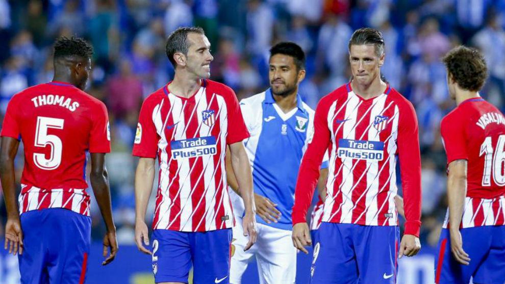 Godín y Torres, tras el empate en Butarque.