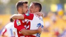 Joselu y Pedro se abranzan tras el gol del segundo en Santo Domingo