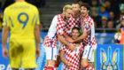 Rakitic, Perisic y Vrsaljko celebran el primer gol de Kramaric.