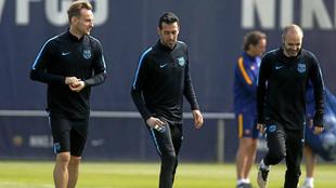 Rakitic, Busquets e Iniesta, en un entrenamiento.