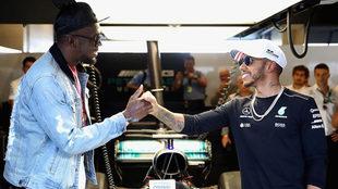 Usain Bolt shakes hands with Lewis Hamilton in Austin, Texas.