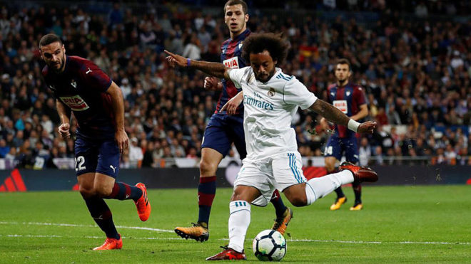 Real Madrid's Marcelo scores their third goal. /