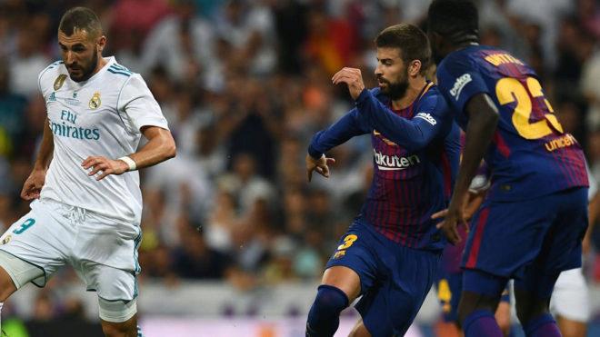 Benzema, Piqué y Umtiti en el último Clásico del Bernabéu.