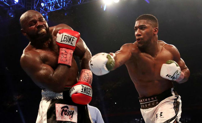 Joshua stops Takam in 10th to retain heavyweight crowns