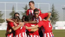 Los jugadores juveniles del Atlético de Madrid celebran la...