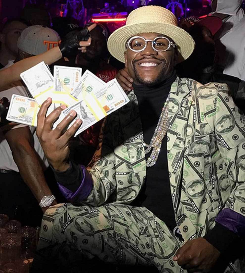 Floyd Mayweather posando con dinero