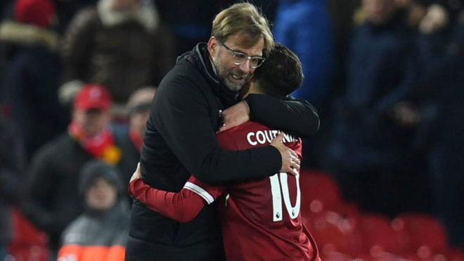 Klopp abraza a Coutinho.