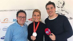 Lydia Valentín junto a Vicente Ortega y José Rodriguez tras la...
