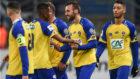 Los jugadores del Sochaux celebra un gol.