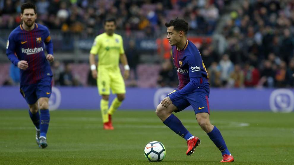 Coutinho, con Messi en segundo plano, el domingo contra el Getafe.