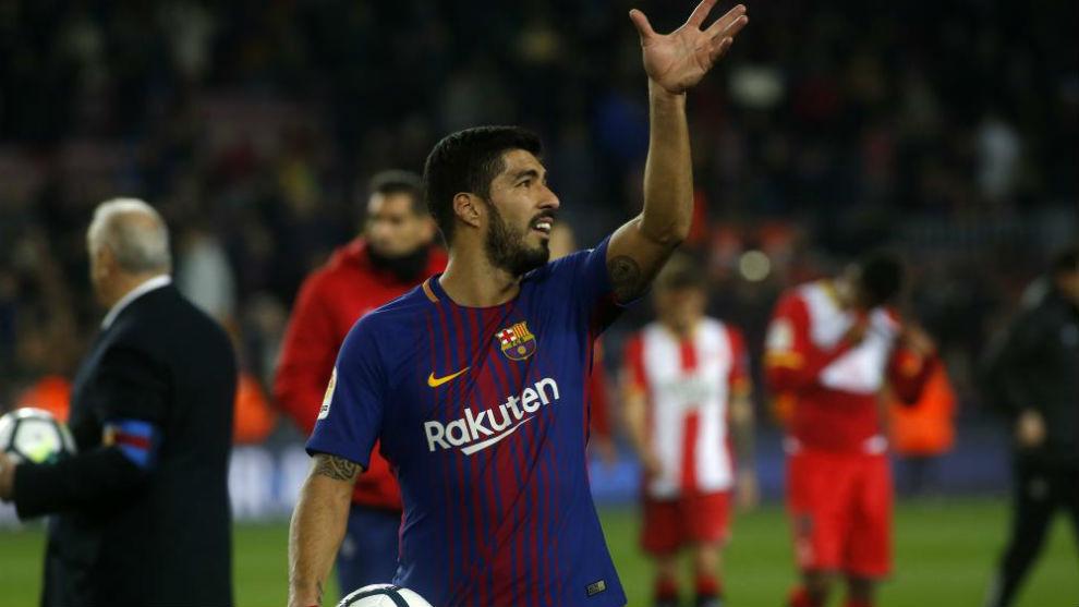 Luis Suárez celebra sus goles ante el Girona.