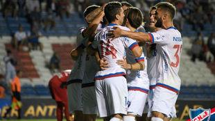 Los jugadores de Nacional celebran su última victoria.