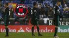 Llorente, Varane y Benzema, cada uno mira hacia un lado después del...