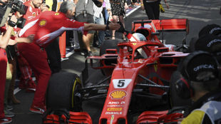 Arrivabene felicita a Vettel.