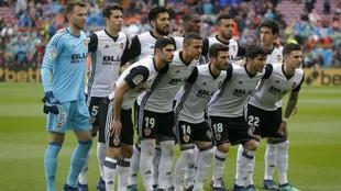 Once titular del Valencia contra el Barcelona.
