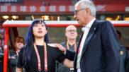 Wen Xiaoting junto a Gregorio Manzano tras el partido del Guizhou...
