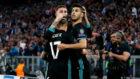 Ramos celebra el gol de Asensio con el mallorquín y con Lucas