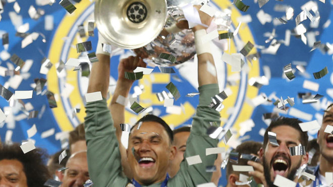 Keylor Navas celebrates with the trophy after the Champions League...