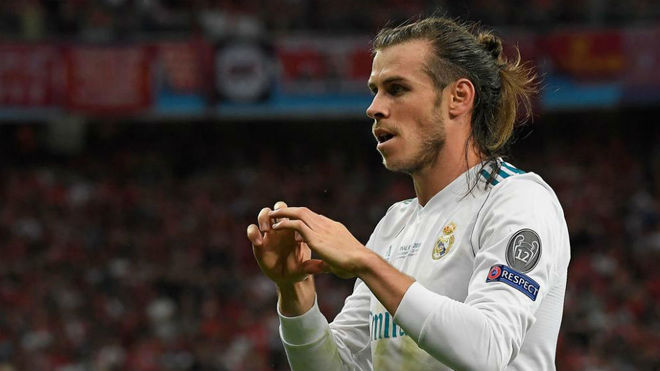 Gareth Bale celebrates after scoring his second goal during the...