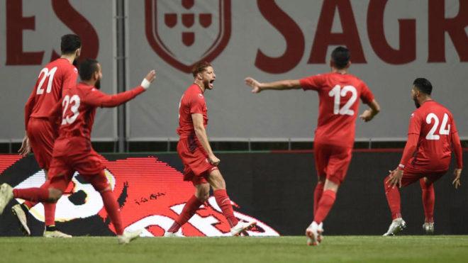 Tunisia's forward Fakhredine Ben Youssef celebrates with teammates...