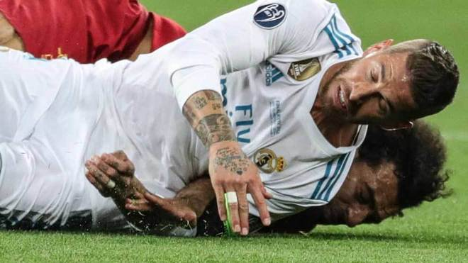 Mohamed Salah and Sergio Ramos fall during the Champions League final