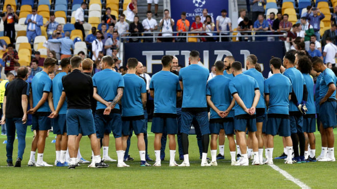 Zinedine Zidane speaks with his players at a Real Madrid team training...