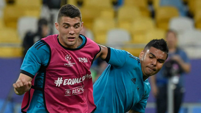 Mateo Kovacic vies with Casemiro during a team's training session
