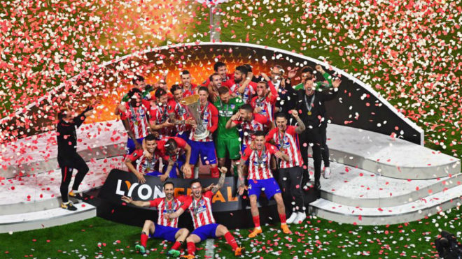 Atletico's players celebrate with the trophy after the Europa League...