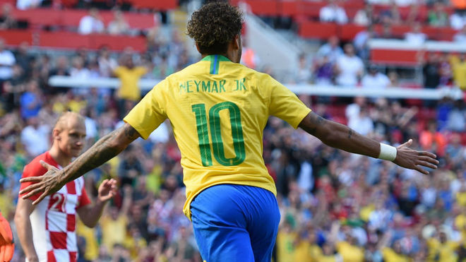 Brazil's striker Neymar celebrates after scoring against Croatia.