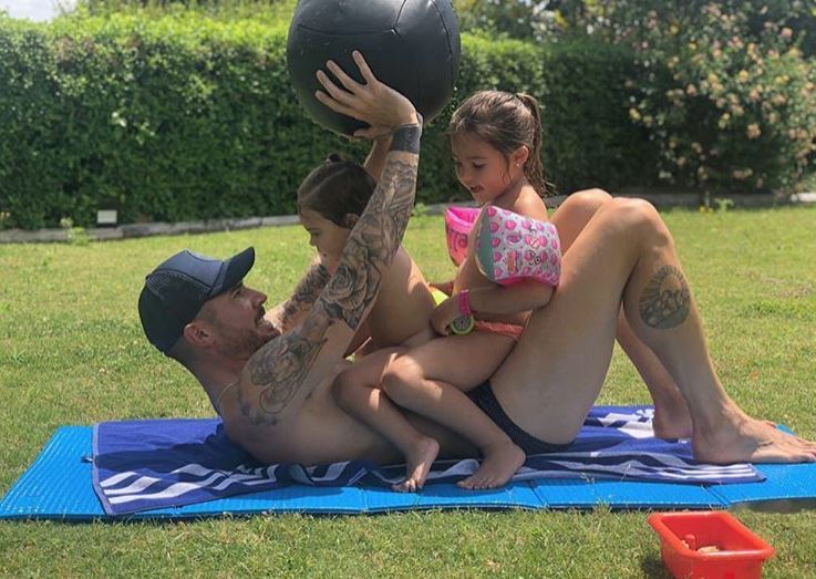 Real Betis enforcer Javi Garcia by the pool with his kids