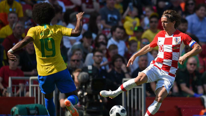 Luka Modric vies with Willian during the International friendly...
