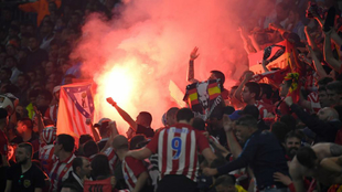 Atletico's fans light flares during the UEFA Europa League final.