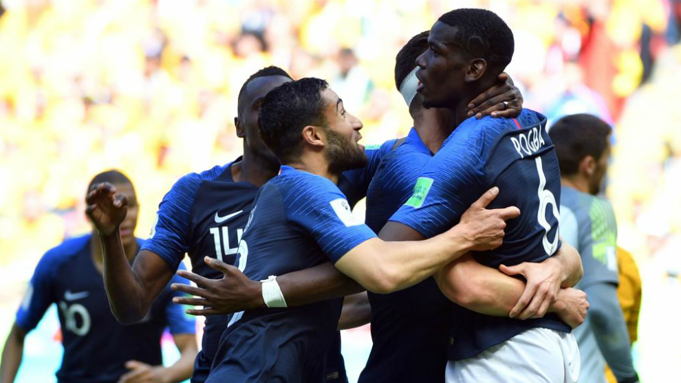 France's midfielder Paul Pogba celebrates with teammates after scoring...