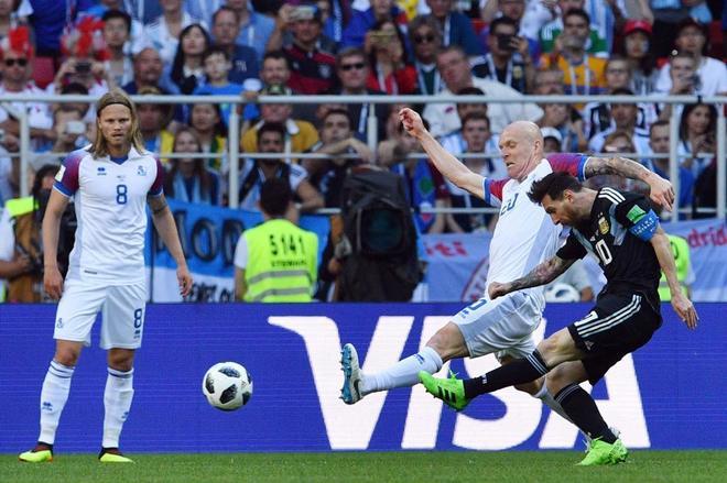 Argentina's forward Lionel Messi (R) challenges Iceland's midfielder...