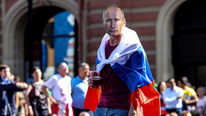 Football fan with the mask depicting the Russian President Vladimir