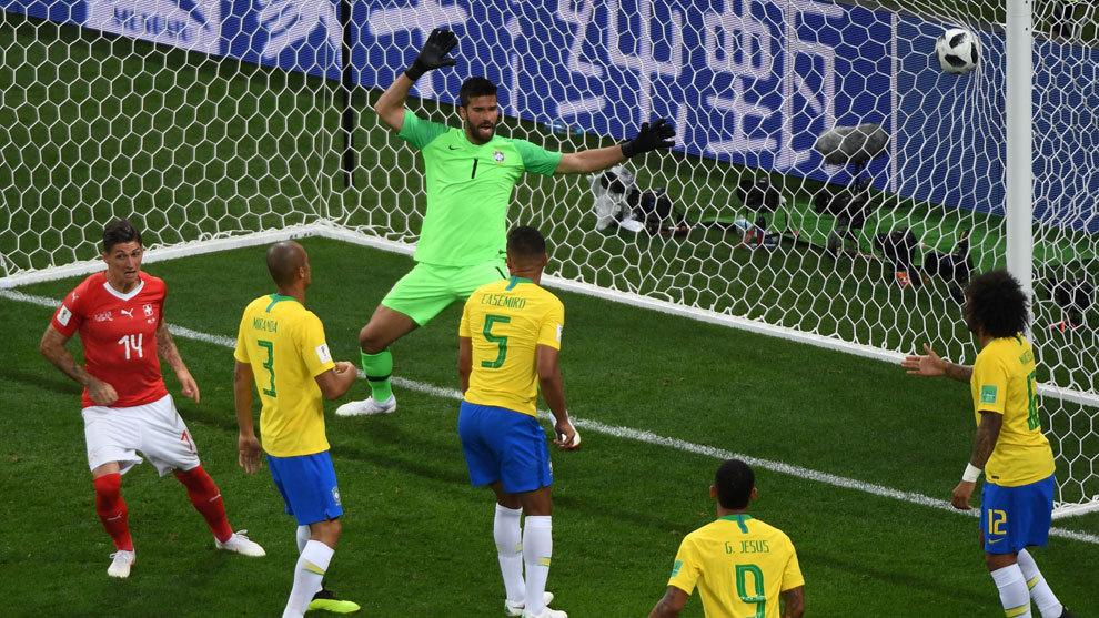 Switzerland's midfielder Steven Zuber scores against Brazil's...